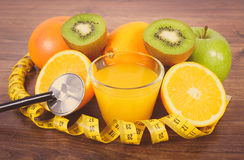 Stethoscope, fresh fruits, juice and centimeter, healthy lifestyles and nutrition Stock Photos