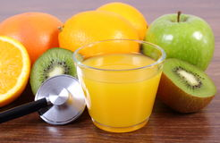 Stethoscope, fresh fruits and juice, healthy lifestyles and nutrition Royalty Free Stock Images