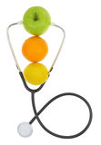 Stethoscope with fresh fruits Stock Photography
