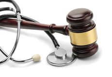 Stethoscope and gavel. Close up of stethoscope and gavel on white background