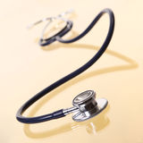 Stethoscope on Gold with Reflection Stock Photography