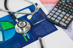 Stethoscope, graph chart, pen and calculator Royalty Free Stock Image