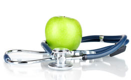 Stethoscope and green apple Royalty Free Stock Image