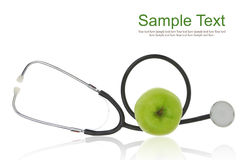 Stethoscope with green apple Royalty Free Stock Photo