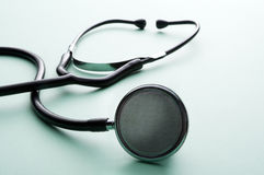 Stethoscope on a green background Stock Image
