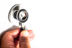 Stethoscope with hand. Stethoscope  and hand with isolated white background Royalty Free Stock Images