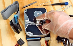 Stethoscope on the hard disk Stock Photos