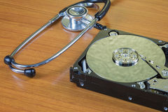 Stethoscope on the hard disk drive Royalty Free Stock Images