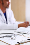 Stethoscope head lying on medical forms closeup Royalty Free Stock Image