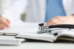 Stethoscope Head Lying On Medical Forms Stock Photos
