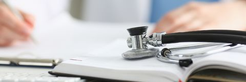 Stethoscope Head Lying On Medical Forms Stock Photography