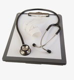 Stethoscope and health chart Stock Photography