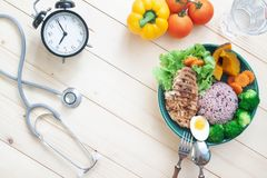 Stethoscope and healthy food with chicken breast and vegetables. stock photography