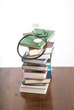 Stethoscope on heap of books Stock Photography