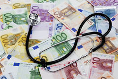 Stethoscope on heap of euro notes Royalty Free Stock Photos