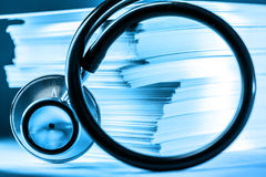 Stethoscope and heap of paper cards Royalty Free Stock Photos