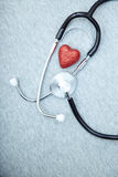 Stethoscope and heart. Medical stethoscope and heart on a blue textured background Royalty Free Stock Images