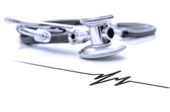 Stethoscope with heart beat sign Royalty Free Stock Images