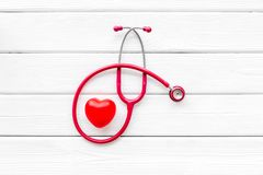 Stethoscope and heart for diagnostic and cure of heart disease on white desk background top view mockup. Office desk for doctor. Health care concept. Stethoscope stock images