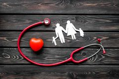 Stethoscope and heart for diagnostic and cure of heart disease on wooden background top view. Office desk for doctor. Health care concept. Stethoscope and heart stock photo