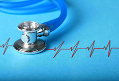 Stethoscope and heart diagram. Stethoscope and heart diagram over blue background stock photography