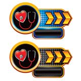 Stethoscope on heart on gold arrow banners Stock Photo