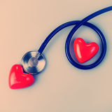 Stethoscope and heart Stock Images