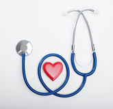 Stethoscope and heart shaped object stock photos