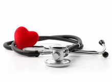 Stethoscope with heart on a white Stock Images