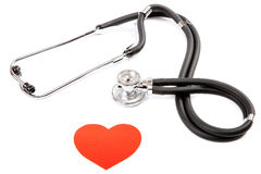 Stethoscope and heart on white background. Stock Photo