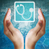 Stethoscope icon in hand Royalty Free Stock Image