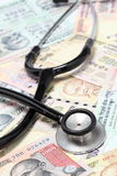 Stethoscope on indian rupee notes Stock Photo