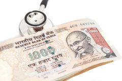 Stethoscope and indian 1000 rupee notes Stock Photos