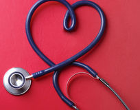 Stethoscope isolated on red background. Stock Images