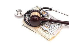 Stethoscope with judge gavel and dollar banknotes Stock Images