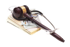 Stethoscope with judge gavel and dollar banknotes Stock Photo