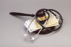 Stethoscope with judge gavel and euro banknotes Stock Photos