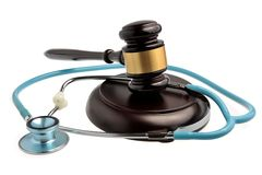 Stethoscope with judge gavel isolated on white Royalty Free Stock Photography