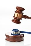 Stethoscope and Judge Hammer. Stethoscope and judges hammer as a symbol for medical errors Royalty Free Stock Images