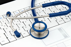 Stethoscope and keyboard Royalty Free Stock Photos