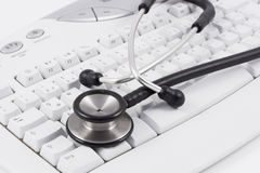 Stethoscope on keyboard Stock Photography