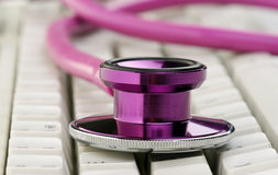 Stethoscope on keyboard Royalty Free Stock Images