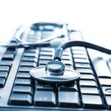Stethoscope on keyboard. Close up photo of stethoscope on keyboard Royalty Free Stock Photo
