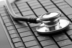 Stethoscope on keyboard Stock Photos