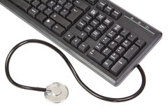 Stethoscope and keyboard Royalty Free Stock Photo