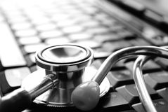 Stethoscope and keyboard Royalty Free Stock Images