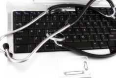 Stethoscope on keyboard Stock Photo
