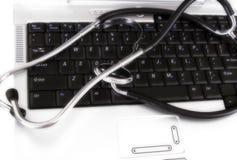 Stethoscope on keyboard. Deliberately over exposed stethoscope on a notebook computer keyboard Stock Photo