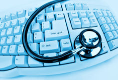 Stethoscope on keyboard. Medical technology or computer problems stethoscope and keyboard on clinical blue Stock Photos