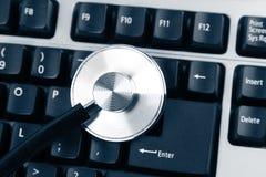 Stethoscope on keyboard Stock Photos